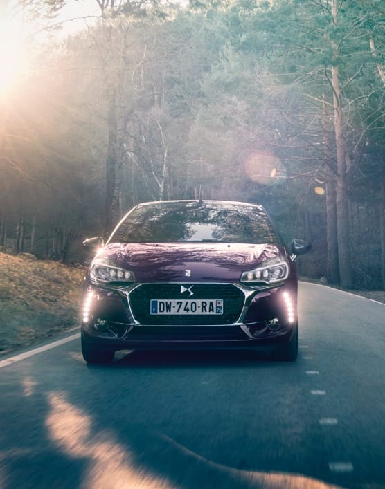 Front view of DS 3 car driving down a country road in the summer sun