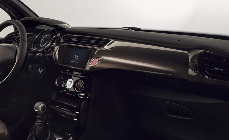 View of DS 3's dark, luxurious interior with media center and climate control