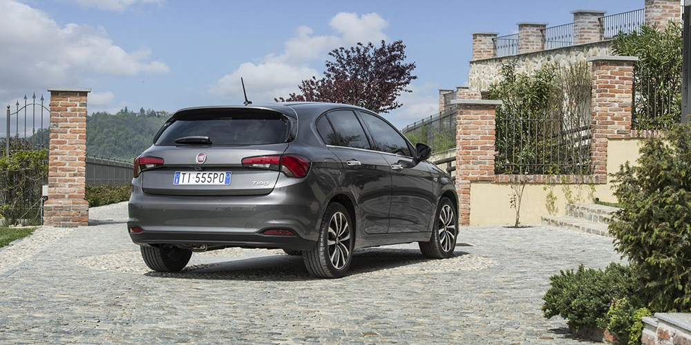 rear 3/4 view of grey fiat tipo