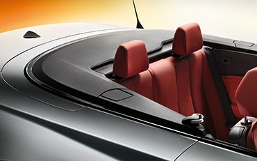 Photograph of the interior of a BMW 2 Series car showing the back seats
