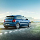 The Volkwagen Polo exterior of car driving on road
