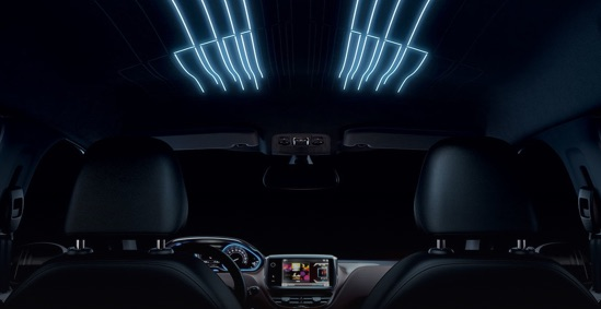 Peugeot 2008 interior in the dark showing bright blue LED ceiling lights.